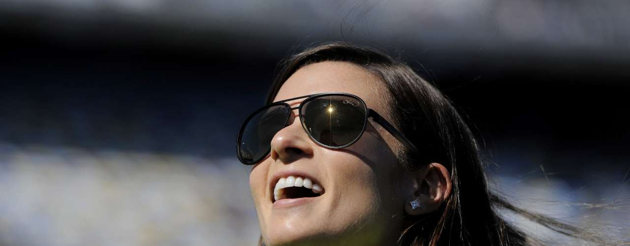 NASCAR Sprint Cup Series driver Danica Patrick, of the number 10 car, speaks with crew members before entering her car to qualify for the Daytona 500, at Daytona International Speedway in Daytona Beach, Florida, February 17, 2013.