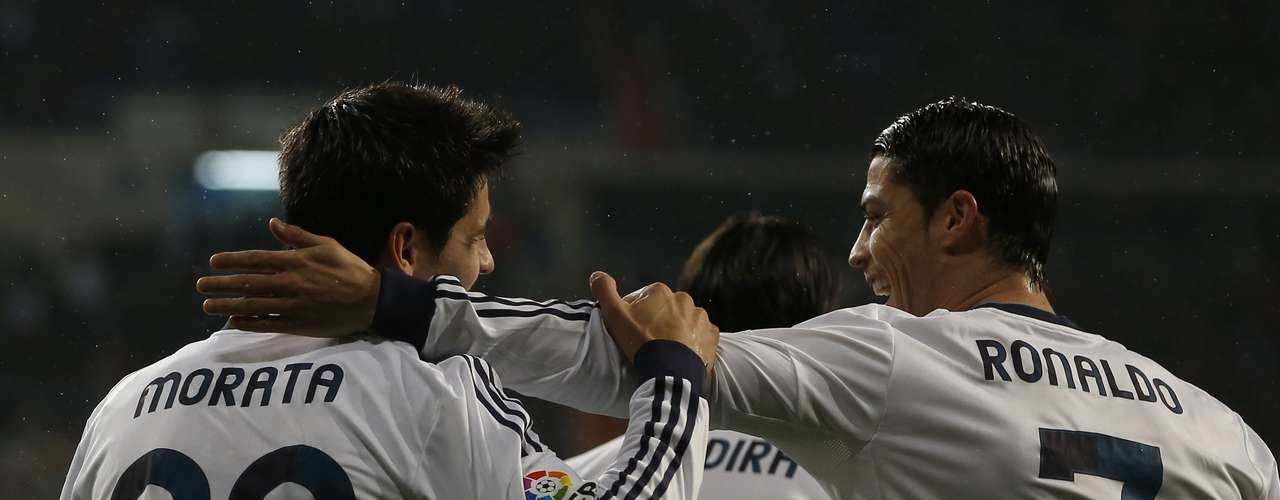 Cristiano Ronaldo congratulates Alvaro Morata after scoring.