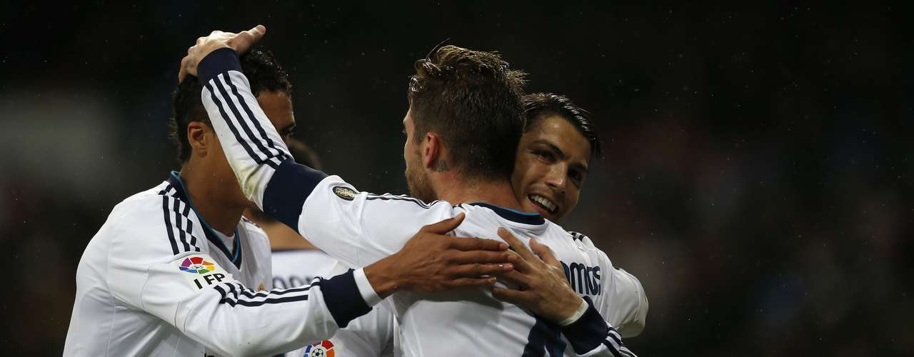 Sergio Ramos (R), Raphael Varane and Cristiano Ronaldo (C) celebrate after Madrid's second goal