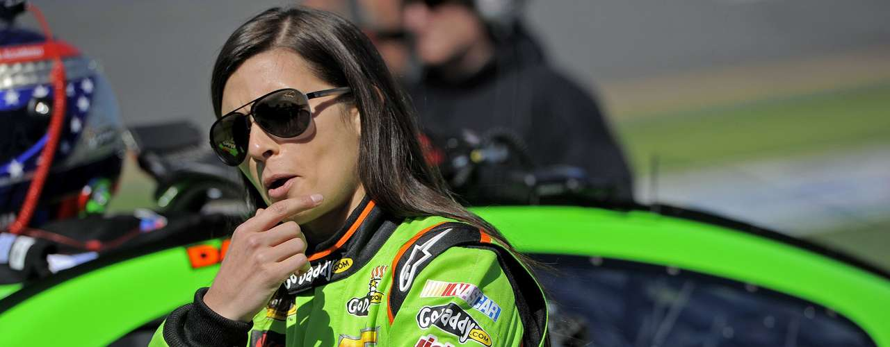 NASCAR Sprint Cup Series driver Danica Patrick, of the number 10 car, speaks with crew members before entering her car to make what would be a Daytona 500 pole position-securing run at qualifying for the Daytona 500, at Daytona International Speedway in Daytona Beach, Florida, February 17, 2013.