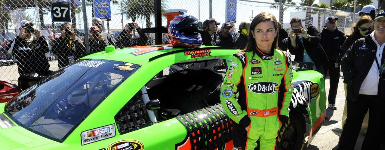 NASCAR Sprint Cup Series driver Danica Patrick, of the number 10 car, exits her vehicle after her Daytona 500 pole position-securing run during qualifying for the Daytona 500, at Daytona International Speedway in Daytona Beach, Florida, February 17, 2013.