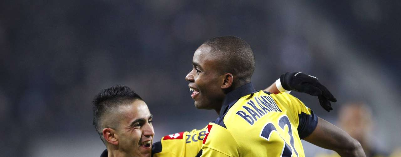 Sochaux's Cedric Bakambu (R) celebrates with team mate Ryad Boudebouz (L) after scoring against Paris Saint Germain during their French Ligue 1 soccer match at the Bonal stadium in Sochaux February 17, 2013.