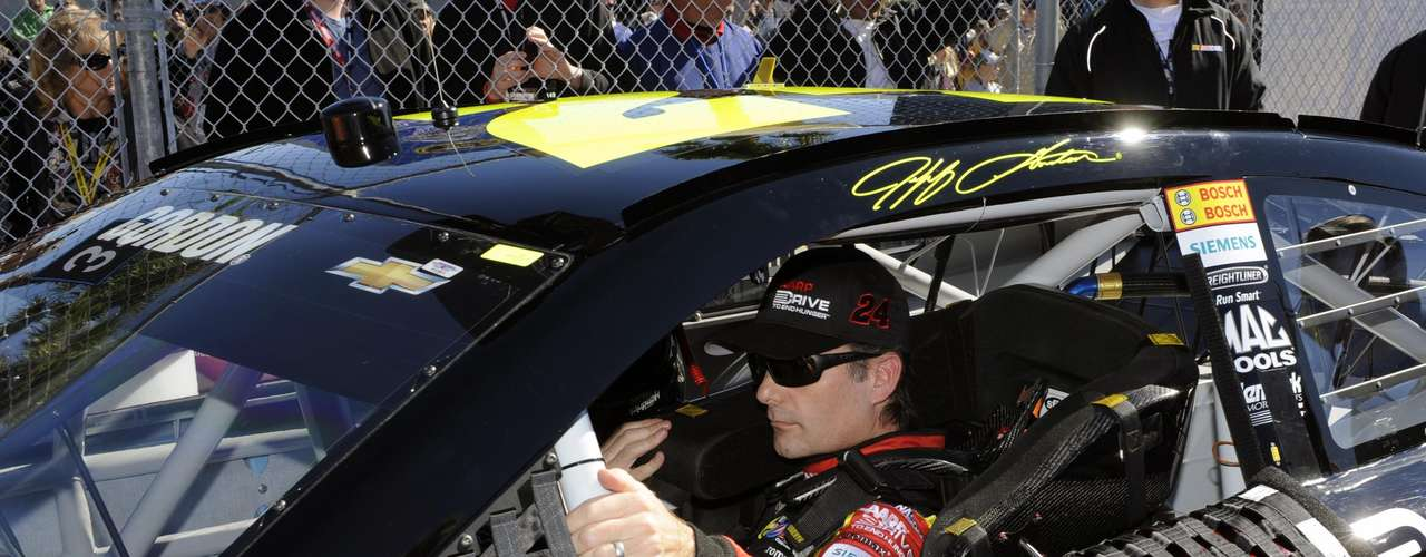 NASCAR Sprint Cup Series driver Jeff Gordon, of the number 24 car, prepares to exit his car after his outside pole-securing run during qualifying for the Daytona 500, at Daytona International Speedway in Daytona Beach, Florida, February 17, 2013.
