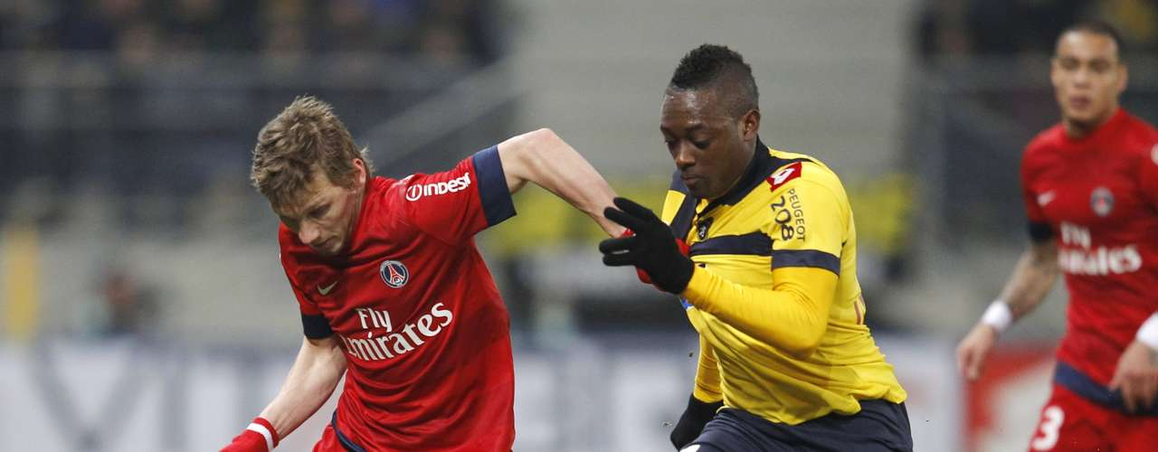 Sochaux's Jerome Roussillon (14) challenges Paris Saint Germain's Clement Chantome during their French Ligue 1 soccer match at the Bonal stadium in Sochaux February 17, 2013.