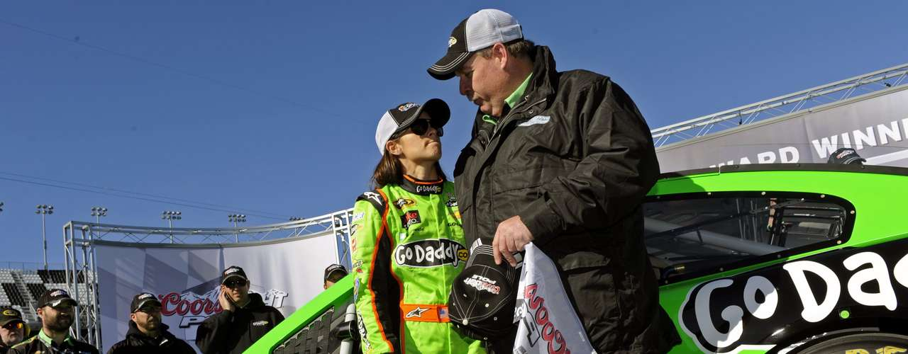 NASCAR Sprint Cup Series driver Danica Patrick (L) of the number 10 car, celebrates securing the pole position for the upcoming Daytona 500, with her crew chief Tony Gibson during qualifying for the race, at Daytona International Speedway in Daytona Beach, Florida, February 17, 2013.