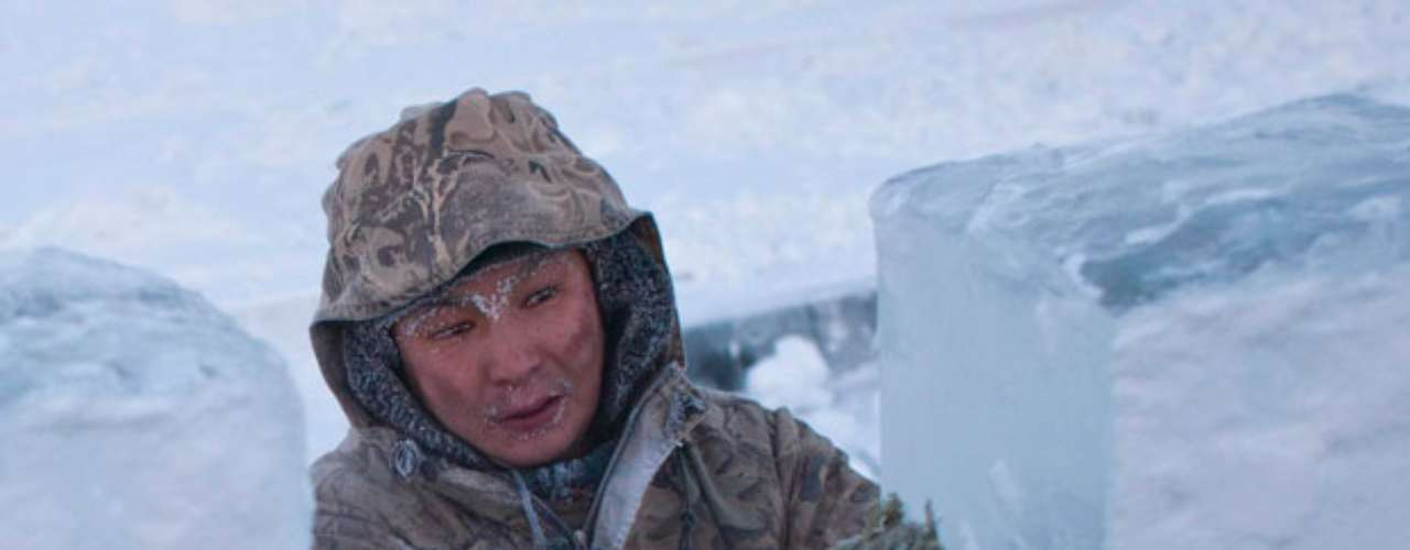 On February 6, 1993 a temperature of -90 ° F was registered in Oymyakon in the Saja Republic, in Northeast Russia. This was the lowest temperature ever recorded in the Northern hemisphere and it is the lowest temperature ever recorder in a location that is permanently inhabited on Earth. In the photo is Rusal, 35, who carries blocks of ice to his truck outside of Yakutsk, capital of the Saja Republic.