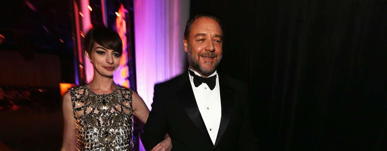 Honoree of LACOSTE Spotlight Award Anne Hathaway and presenter Russell Crowe attend the 15th Annual Costume Designers Guild Awards with presenting sponsor Lacoste at The Beverly Hilton Hotel on February 19, 2013 in Beverly Hills, California.