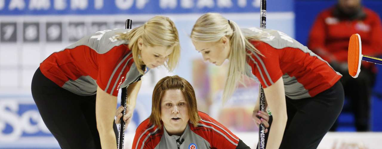 REFILE - CORRECTING IDENTITY OF PLAYER ON LEFT  Northwest Territories/Yukon skip Kerry Galusha throws a rock with team mates Megan Cormier (R) and Wendy Miller (L) against Nova Scotia during the eighth draw at Scotties Tournament of Hearts curling championship in Kingston February 19, 2013.    REUTERS/Mark Blinch (CANADA - Tags: SPORT CURLING)