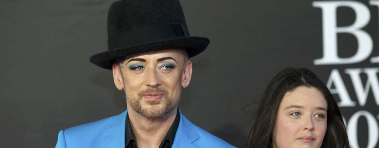 REFILE - REMOVING DISCLAIMER  Singer Boy George and a companion arrive for the BRIT Awards at the O2 Arena in London February 20, 2013.   REUTERS/Luke Macgregor (BRITAIN  - Tags: ENTERTAINMENT SOCIETY)