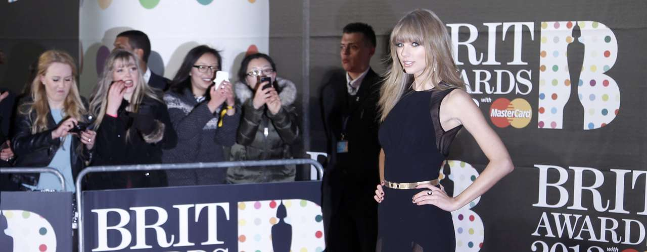 U.S. singer Taylor Swift arrives for the BRIT Awards, celebrating British pop music, at the O2 Arena in London February 20, 2013. REUTERS/Luke Macgregor (BRITAIN  - Tags: ENTERTAINMENT)