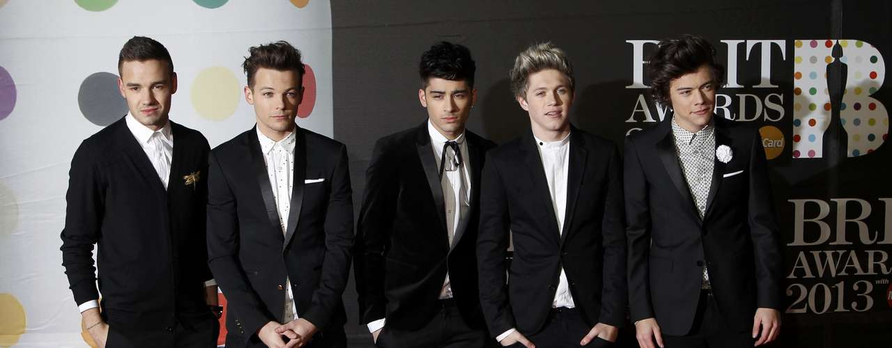 British pop group One Direction arrive for the BRIT Awards, celebrating British pop music, at the O2 Arena in London February 20, 2013. REUTERS/Luke Macgregor (BRITAIN  - Tags: ENTERTAINMENT)