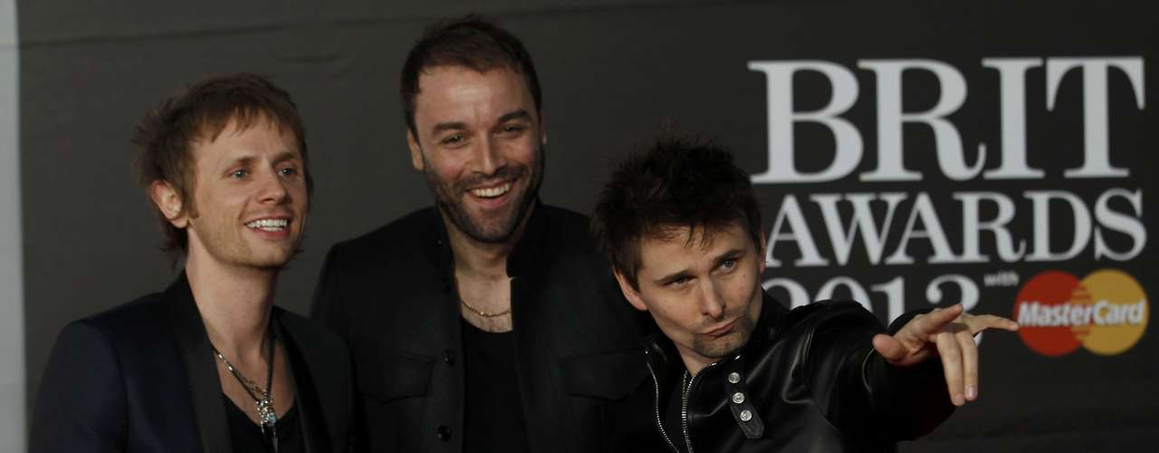 Rock band Muse arrive for the BRIT Awards, celebrating British pop music, at the O2 Arena in London February 20, 2013. REUTERS/Luke Macgregor (BRITAIN  - Tags: ENTERTAINMENT)
