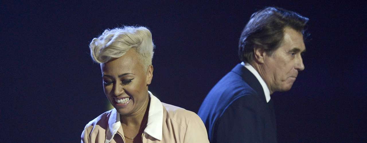 Singer Emeli Sande reacts after being awarded the best British Album award by Bryan Ferry (R) during the BRIT Awards, celebrating British pop music, at the O2 Arena in London February 20, 2013.    REUTERS/Dylan Martinez (BRITAIN  - Tags: ENTERTAINMENT SOCIETY) FOR EDITORIAL USE ONLY. NOT FOR SALE FOR MARKETING OR ADVERTISING CAMPAIGNS.