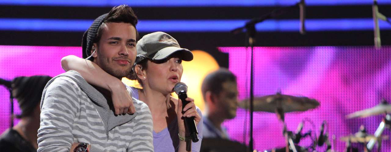 Thalia and Prince Royce have a good time practicing their duet.