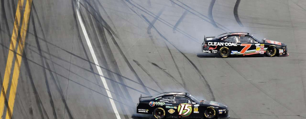 NASCAR drivers Regan Smith (7) in his Chevrolet and Juan Carlos Blum (15) in his Ford spin out of control during the NASCAR Nationwide Series before the more serious accident. REUTERS/Pierre Ducharme