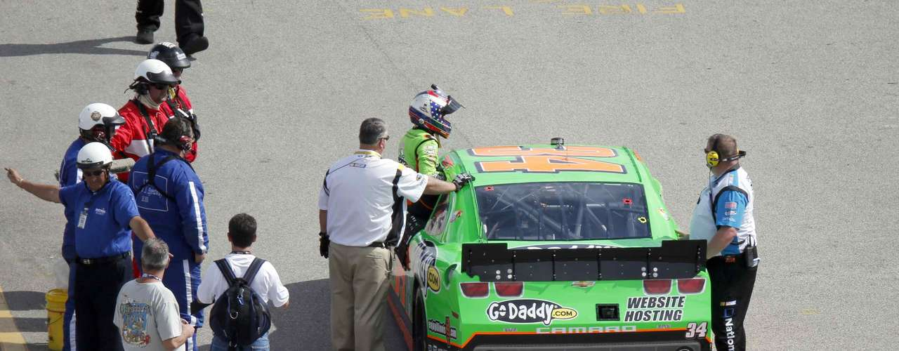 NASCAR driver Danica Patrick climbs out of her Chevrolet in the garage area after losing power during the NASCAR Nationwide Series DRIVE4COPD 300.