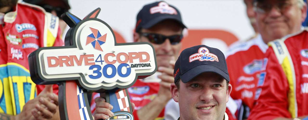 NASCAR driver Tony Stewart holds the trophy after winning the NASCAR Nationwide Series DRIVE4COPD 300 race at the Daytona International Speedway. The accident took place on the final lap, and Stewart was able to escape injury.