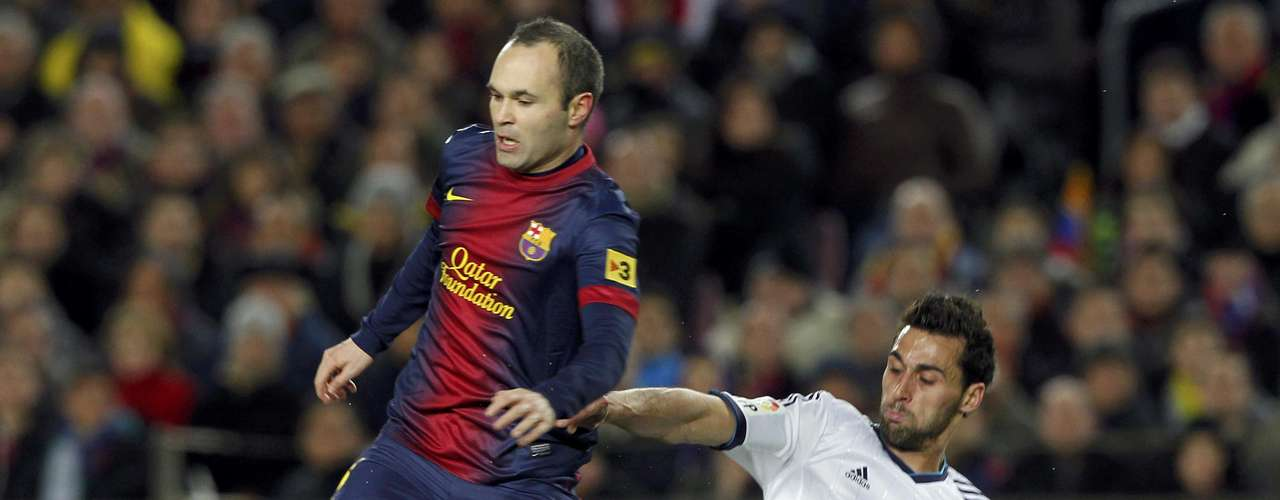 Barcelona's Andres Iniesta (L) is tackled by Real Madrid's Alvaro Arbeloa during their Spanish King's Cup semifinal second round.