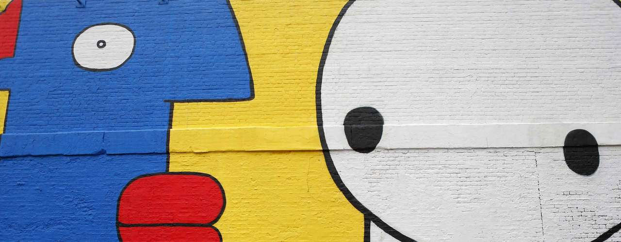 Pared pintada por el artista Stik and Thierry Noir al este de Londres