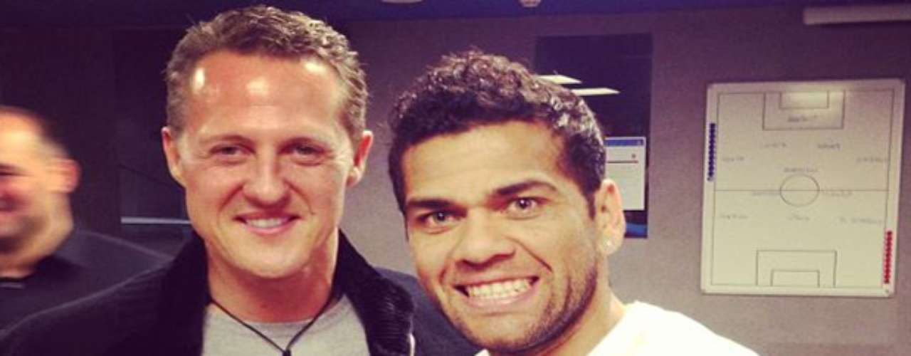 Brazilian back Dani Alves poses with Formula One legend Michael Schumacher. In his tweet he says that \