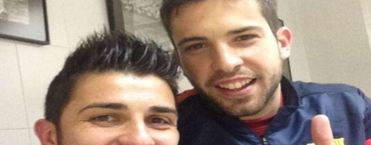 David Villa y Jordi Albadespués de que ambos anotarondurante el partido.