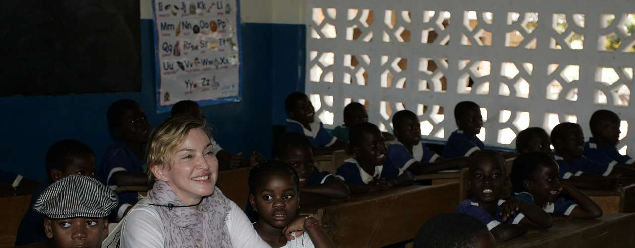 The philanthropist singer and her children, adopted and biological, David Banda, Lourdes, Mercy James, and Rocco traveled to Malawi's Mkoko Primary School, one of the schools Madonna's Raising Malawi organization has built with US organization BuildOn, on April 2. Madonna, who is the single largest international philanthropic donor to Malawi, also supports childcare in the country which is home to nearly a million children orphaned by AIDS.