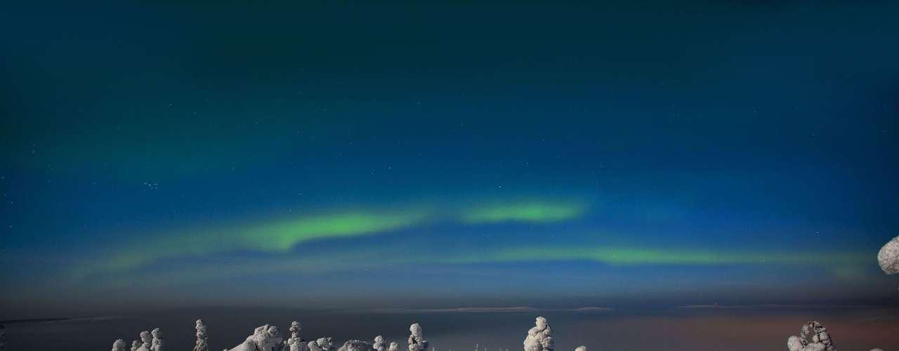 Este extraño paisaje está compuesto de árboles cubiertos de nieve y la aurora boreal. El registro oficial fue realizadopor Tiina Maisala Tormanen, en Finlandia, a una temperatura de -20 °C.