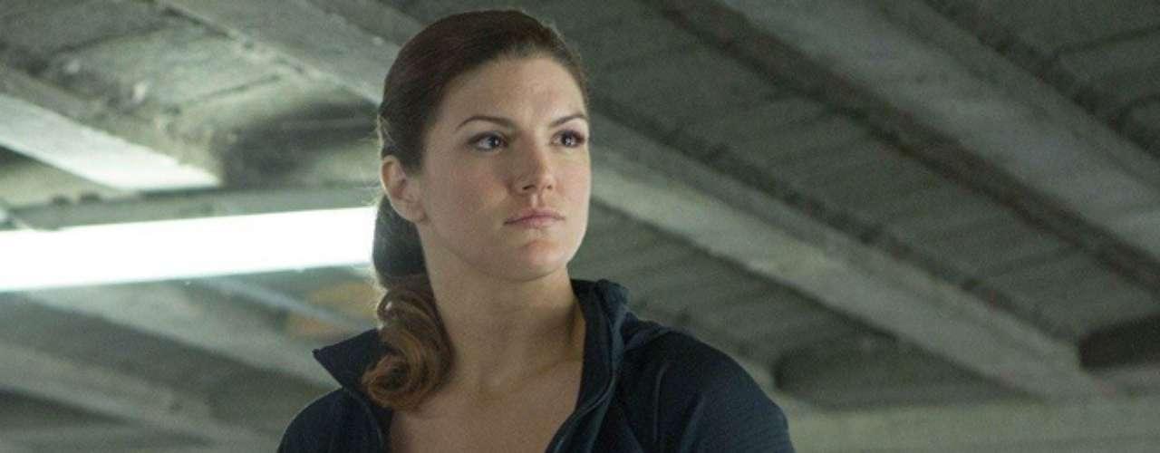 La exartista marcial y modelo Gina Carano hizo su gran debut en el cine de la mano de Steven Soderbergh en 'Haywire' el año pasado. Ahora le dio vida a la agente del Servicio Diplomático de Estados Unidos, Riley.