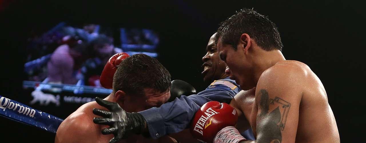 El Chino Maidana noquéo en el sexto asalto a Josesito López y retuvo su título Intercontinental Welter de la AMB,