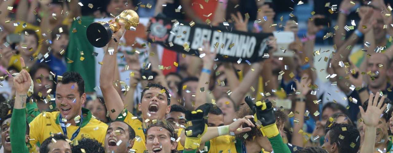 Brazil captainThiago Silva raises the Confederations Cup trophy