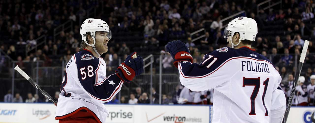 Dec 12, 2013; New York, NY, USA; Columbus Blue Jackets defenseman David Savard (58) is congratulated by left wing Nick Foligno (71) after scoring a goal against the New York Rangers during the first period at Madison Square Garden. Mandatory Credit: Adam Hunger-USA TODAY Sports