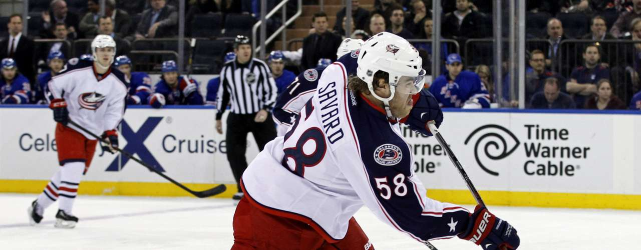 Dec 12, 2013; New York, NY, USA; Columbus Blue Jackets defenseman David Savard (58) shoots and scores a goal against the New York Rangers during the first period at Madison Square Garden. Mandatory Credit: Adam Hunger-USA TODAY Sports