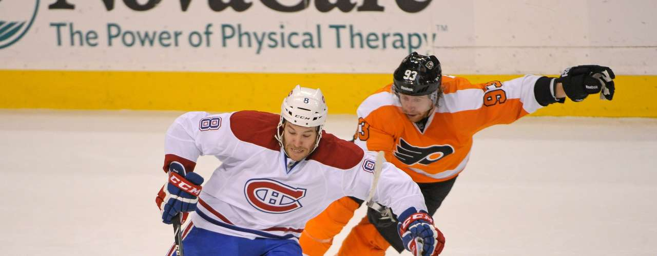 Dec 12, 2013; Philadelphia, PA, USA; Montreal Canadiens right wing Brandon Prust (8) skates past Philadelphia Flyers right wing Jakub Voracek (93) during the first period at Wells Fargo Center. Mandatory Credit: Eric Hartline-USA TODAY Sports