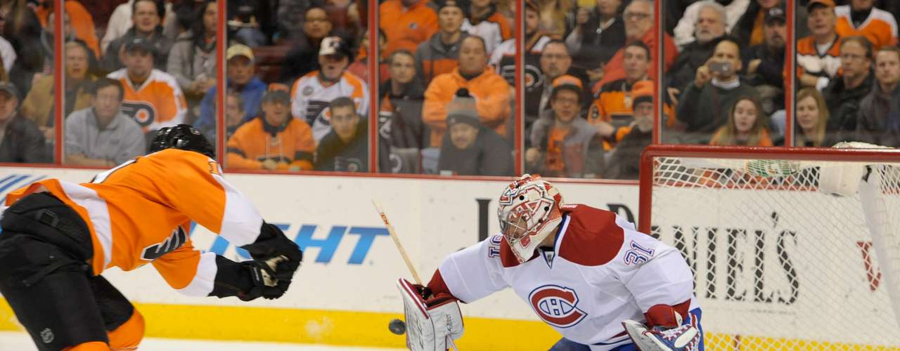 Dec 12, 2013; Philadelphia, PA, USA; Montreal Canadiens goalie Carey Price (31) makes a save against Philadelphia Flyers center Brayden Schenn (10) during the second period at Wells Fargo Center. Mandatory Credit: Eric Hartline-USA TODAY Sports