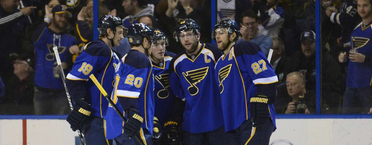 Dec 12, 2013; St. Louis, MO, USA; St. Louis Blues center David Backes (42) celebrates his goal with teammates during the first period against the Toronto Maple Leafs at the Scottrade Center. Mandatory Credit: Jeff Curry-USA TODAY Sports