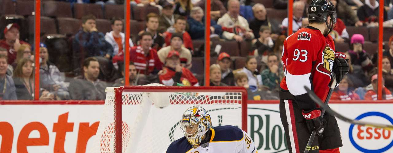 Dec 12, 2013; Ottawa, Ontario, CAN; Buffalo Sabres goalie Ryan Miller (30) makes a save as Ottawa Senators center Mika Zibanejad (93) screens him in the second period at the Canadian Tire Centre. Mandatory Credit: Marc DesRosiers-USA TODAY Sports