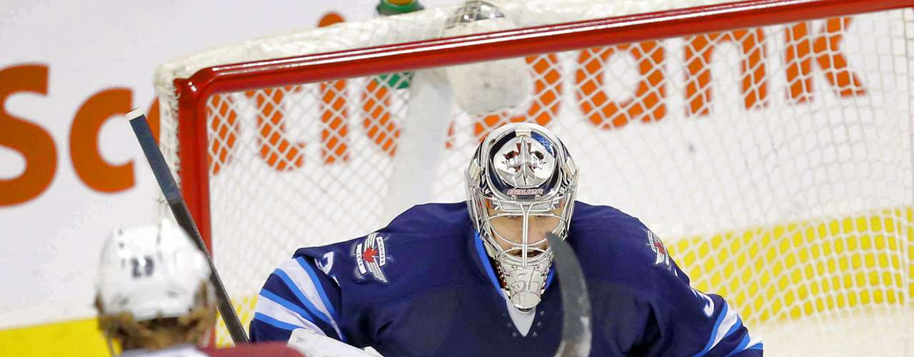 Dec 12, 2013; Winnipeg, Manitoba, CAN; Winnipeg Jets goalie Ondrej Pavelec (31) makes a save against the Colorado Avalanche during the second period at the MTS Center. Mandatory Credit: Bruce Fedyck-USA TODAY Sports