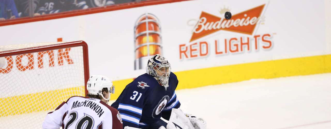 Dec 12, 2013; Winnipeg, Manitoba, CAN; Winnipeg Jets goalie Ondrej Pavelec (31) follows the puck during the second period against the Colorado Avalanche at the MTS Center. Mandatory Credit: Bruce Fedyck-USA TODAY Sports
