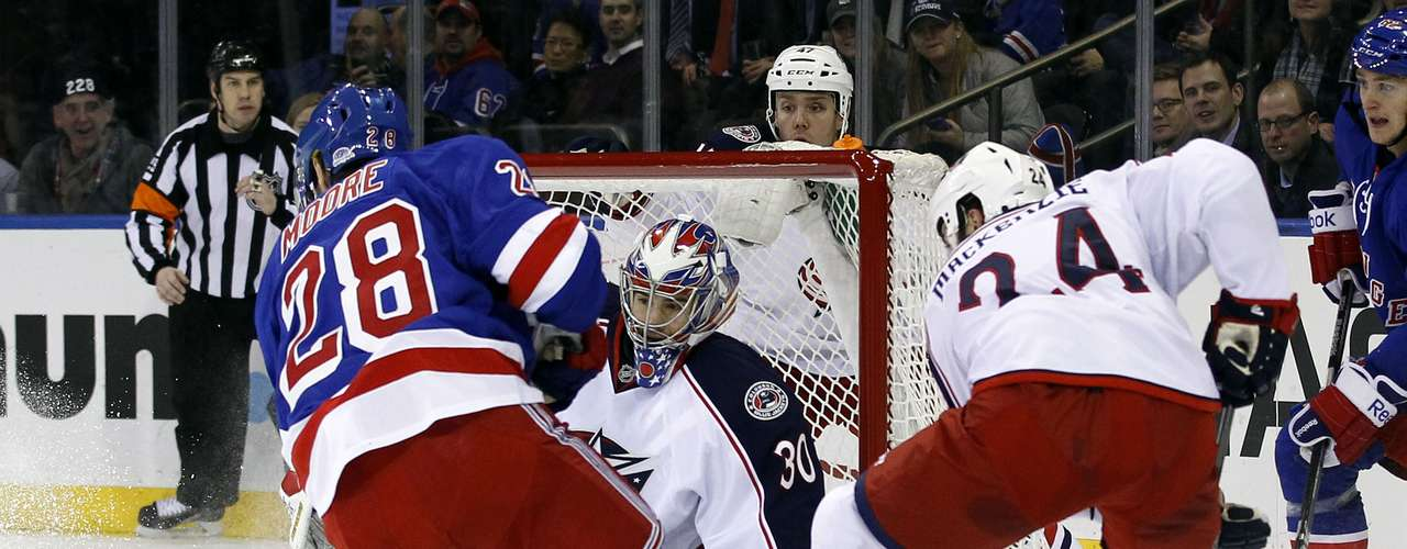Dec 12, 2013; New York, NY, USA; Columbus Blue Jackets goalie Mike McKenna (30) makes a save on a shot by New York Rangers center Dominic Moore (28) during the second period at Madison Square Garden. The Columbus Blue Jackets beat the New York Rangers 4-2. Mandatory Credit: Adam Hunger-USA TODAY Sports