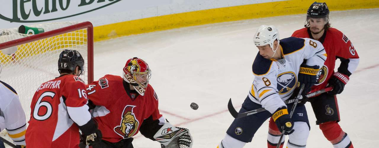 Dec 12, 2013; Ottawa, Ontario, CAN;  Ottawa Senators goalie Craig Anderson (41) makes a save in the third period at the Canadian Tire Centre as Buffalo Sabres center Cody McCormick (8) checks for the rebound. The Senators defeated the Sabres 2-1. Mandatory Credit: Marc DesRosiers-USA TODAY Sports