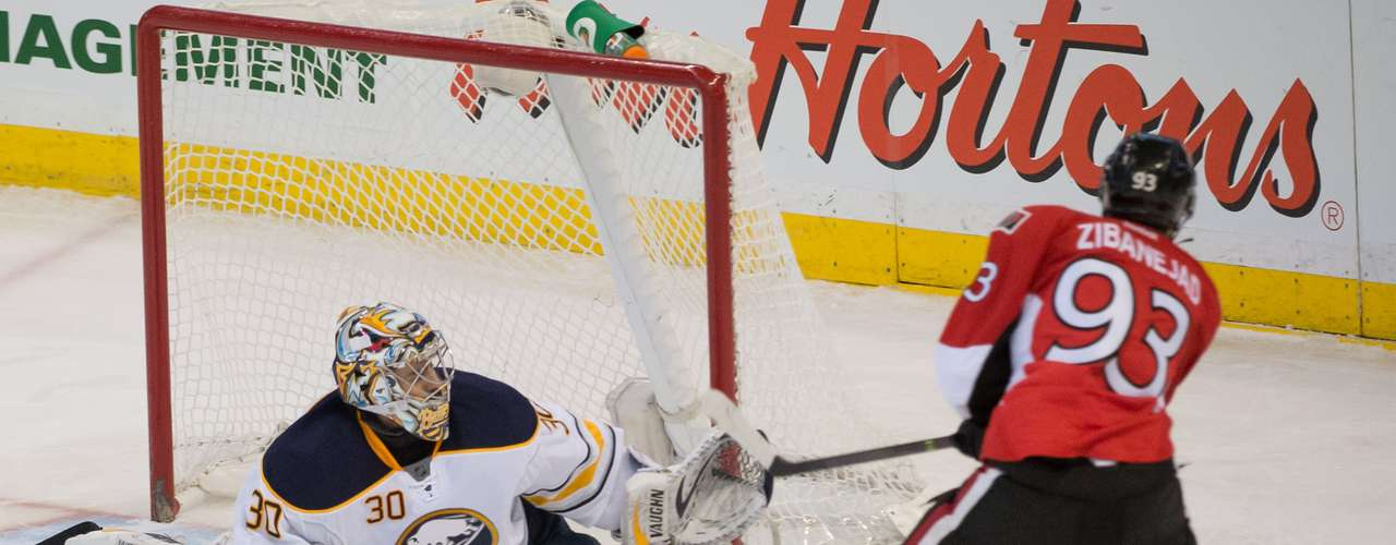 Dec 12, 2013; Ottawa, Ontario, CAN; Buffalo Sabres goalie Ryan Miller (30) makes a save on a shot from Ottawa Senators center Mika Zibanejad (93) in the third period at the Canadian Tire Centre.The Senators defeated the Sabres 2-1. Mandatory Credit: Marc DesRosiers-USA TODAY Sports