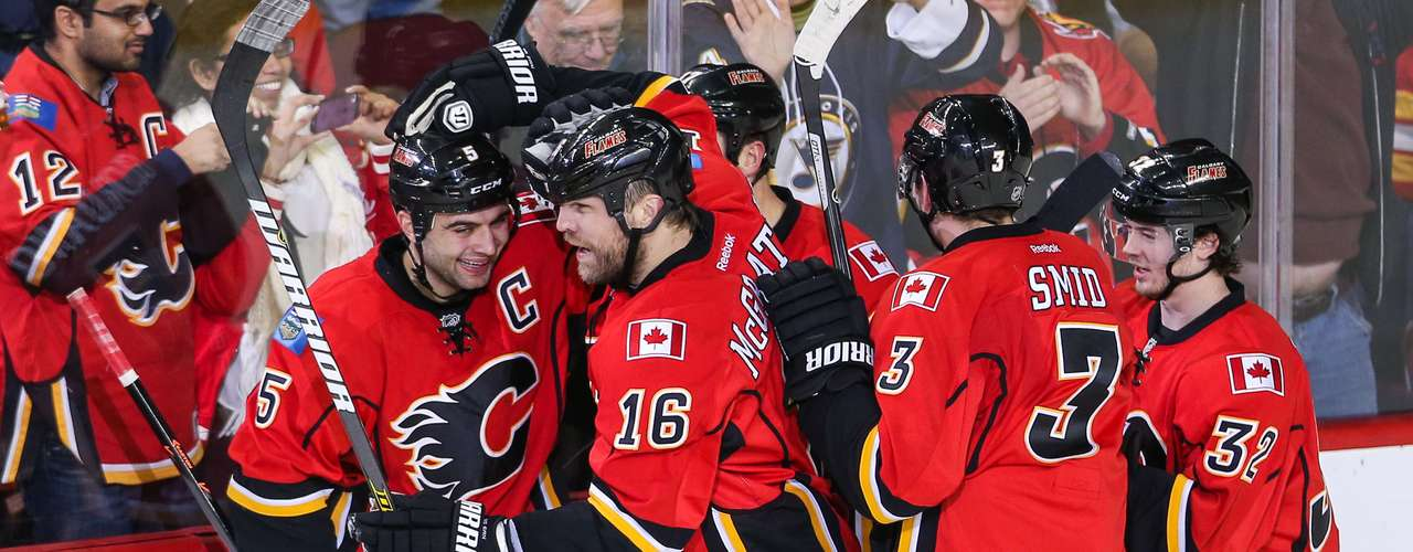 Dec 12, 2013; Calgary, Alberta, CAN; Calgary Flames right wing Brian McGrattan (16) celebrates his goal with teammates against the Carolina Hurricanes during the second period at Scotiabank Saddledome. Mandatory Credit: Sergei Belski-USA TODAY Sports