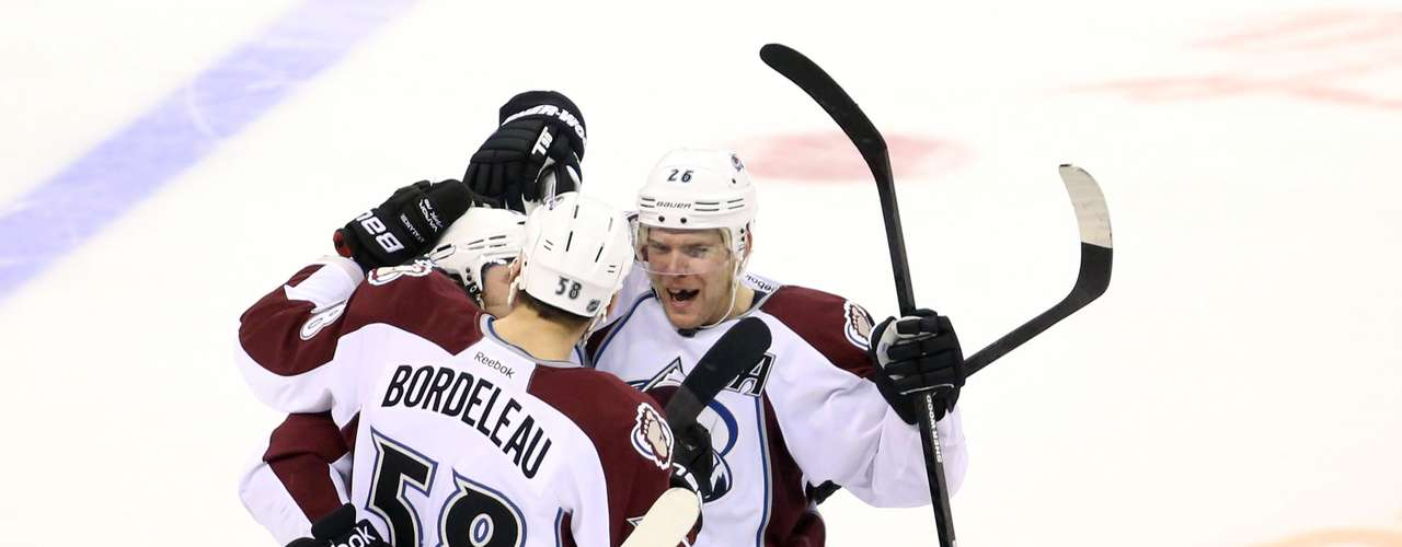 Dec 12, 2013; Winnipeg, Manitoba, CAN; Colorado Avalanche forward P.A. Parenteau (15) celebrates with teammates after scoring in the shootout to defeat the Winnipeg Jets at the MTS Center. Colorado wins 4-3 overtime. Mandatory Credit: Bruce Fedyck-USA TODAY Sports