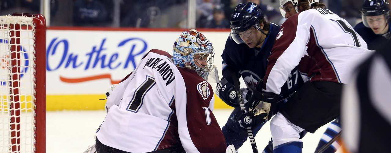 Dec 12, 2013; Winnipeg, Manitoba, CAN;  Colorado Avalanche goalie Semyon Varlamov (1) defends against the Winnipeg Jets during the third period at the MTS Center. Colorado wins 4-3 overtime. Mandatory Credit: Bruce Fedyck-USA TODAY Sports