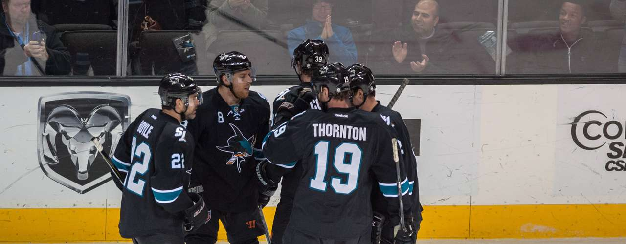 Dec 12, 2013; San Jose, CA, USA; San Jose Sharks center Joe Pavelski (8) celebrates with teammates after scoring a goal against the Minnesota Wild during the first period at SAP Center at San Jose. Mandatory Credit: Ed Szczepanski-USA TODAY Sports