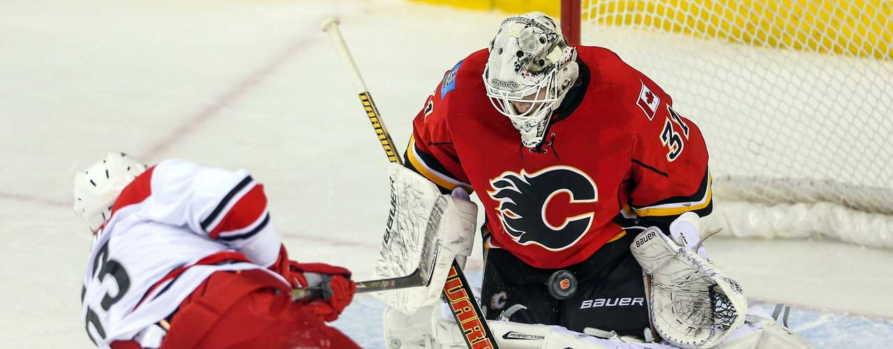 Dec 12, 2013; Calgary, Alberta, CAN; Calgary Flames goalie Karri Ramo (31) makes a save on a penalty shot by Carolina Hurricanes left wing Jeff Skinner (53) during the third period at Scotiabank Saddledome. Calgary Flames won 2-1. Mandatory Credit: Sergei Belski-USA TODAY Sports