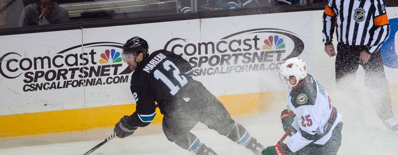 Dec 12, 2013; San Jose, CA, USA; San Jose Sharks center Patrick Marleau (12) controls the puck against Minnesota Wild defenseman Jonas Brodin (25) during the first period at SAP Center at San Jose. Mandatory Credit: Ed Szczepanski-USA TODAY Sports