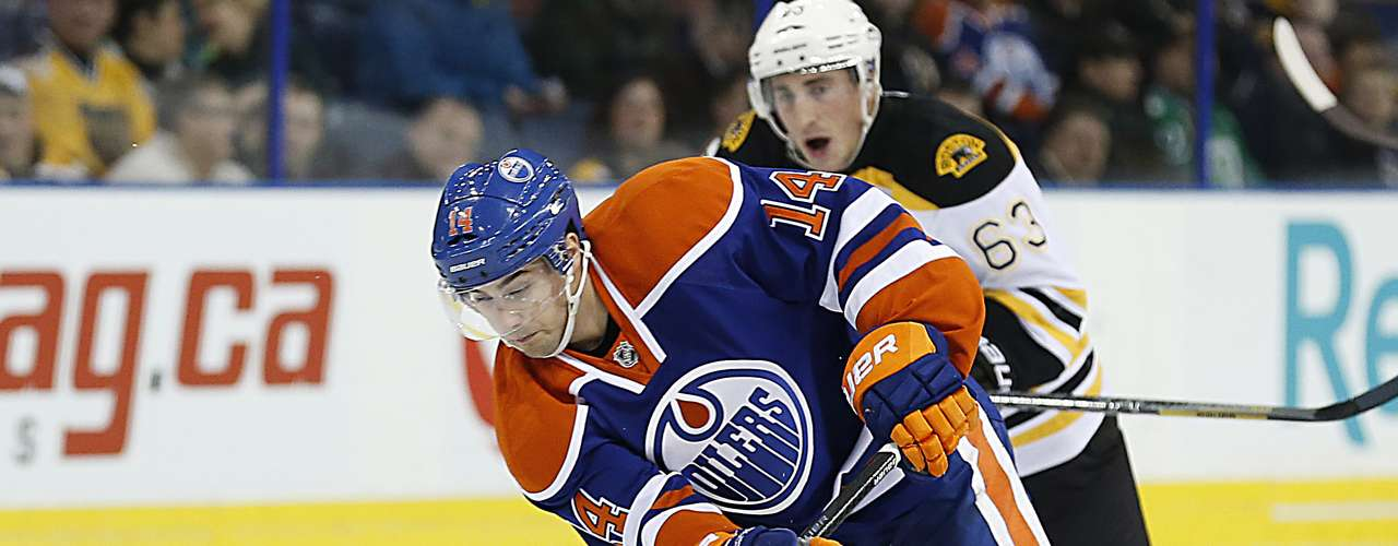 Dec 12, 2013; Edmonton, Alberta, CAN;  Edmonton Oilers forward Jordan Eberle (14) carries the puck up ice against the Boston Bruins during the third period at Rexall Place. Mandatory Credit: Perry Nelson-USA TODAY Sports