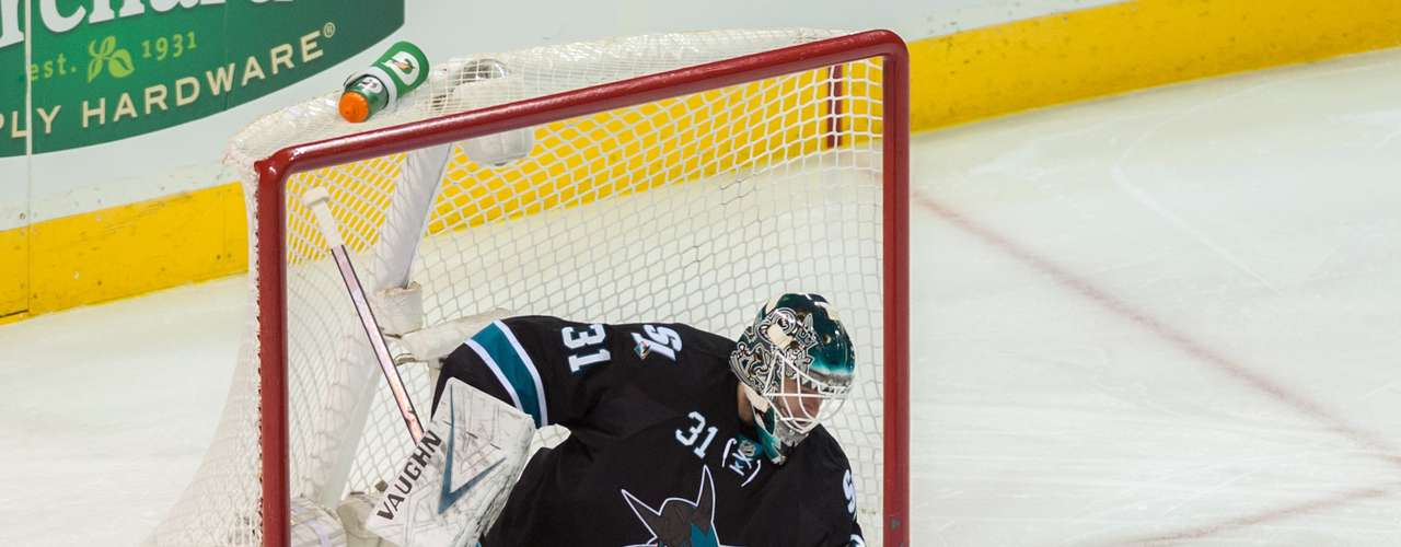 Dec 12, 2013; San Jose, CA, USA; San Jose Sharks goalie Antti Niemi (31) gloves the puck against the Minnesota Wild during the first period at SAP Center at San Jose. Mandatory Credit: Ed Szczepanski-USA TODAY Sports