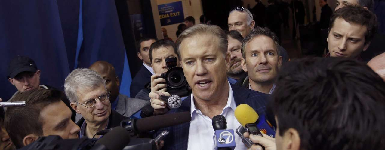 John Elway, former quarterback and now executive vice president of football operations of the Denver Broncos, answers reporters' questions.